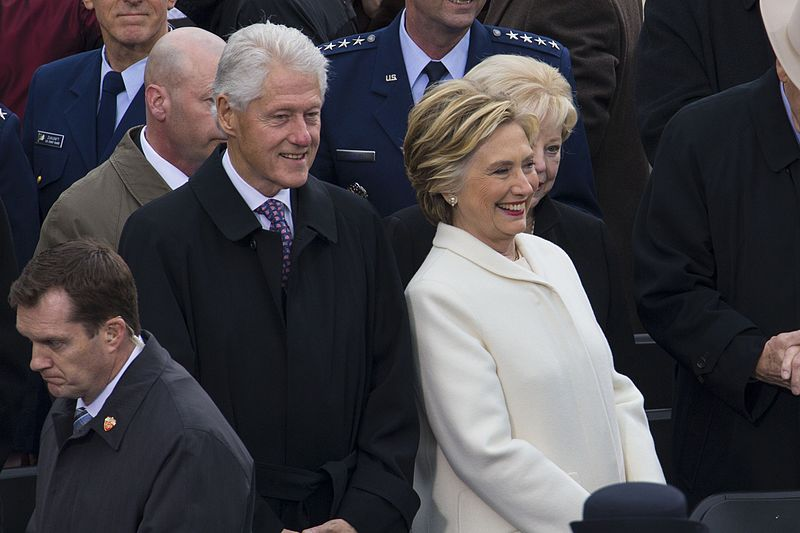 Bill and Hillary laughing public domain